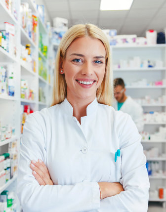 pharmacist with blonde hair smiling