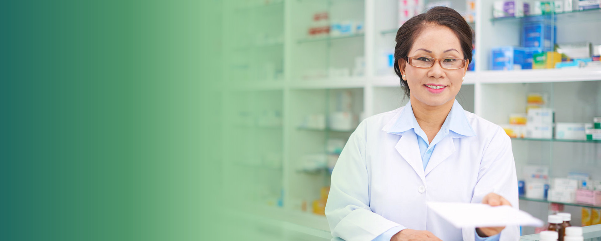 adult female pharmacist smiling