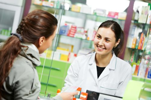 pharmacists talking with female customers