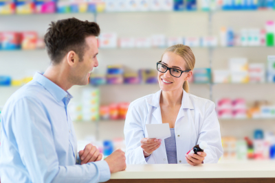 pharmacist wearing eyeglasses talking with the adult man clinical services
