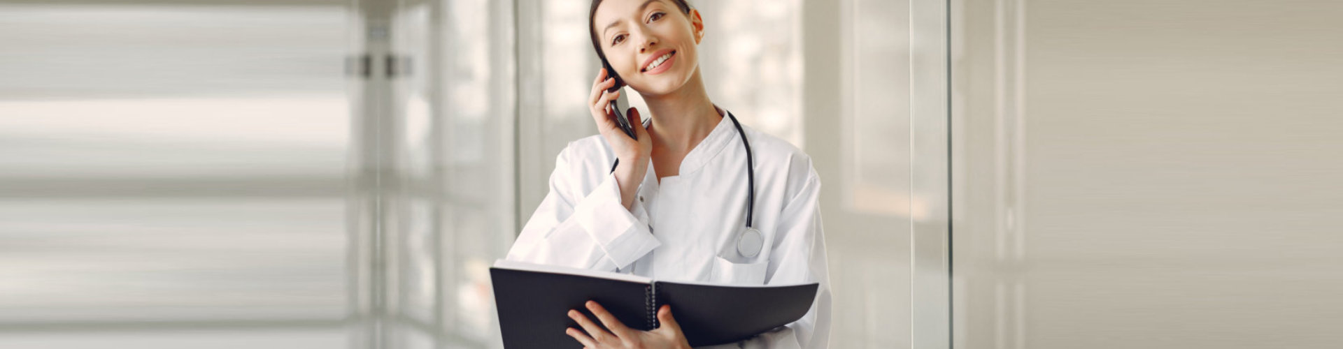 female pharmacist taking a phone call